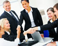 six people in business attire shaking hands, this photo links to the ExecEd webpage