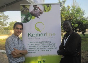 MirHossein and another gentleman standing beside a Farmerline sign.