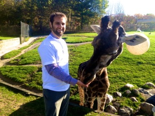 Daniel Bida and a friend at the Toronto Zoo. Zooshare recycles 3,000 tonnes of animal manure from the Toronto Zoo each year and turns it into renewable power for the Ontario grid.