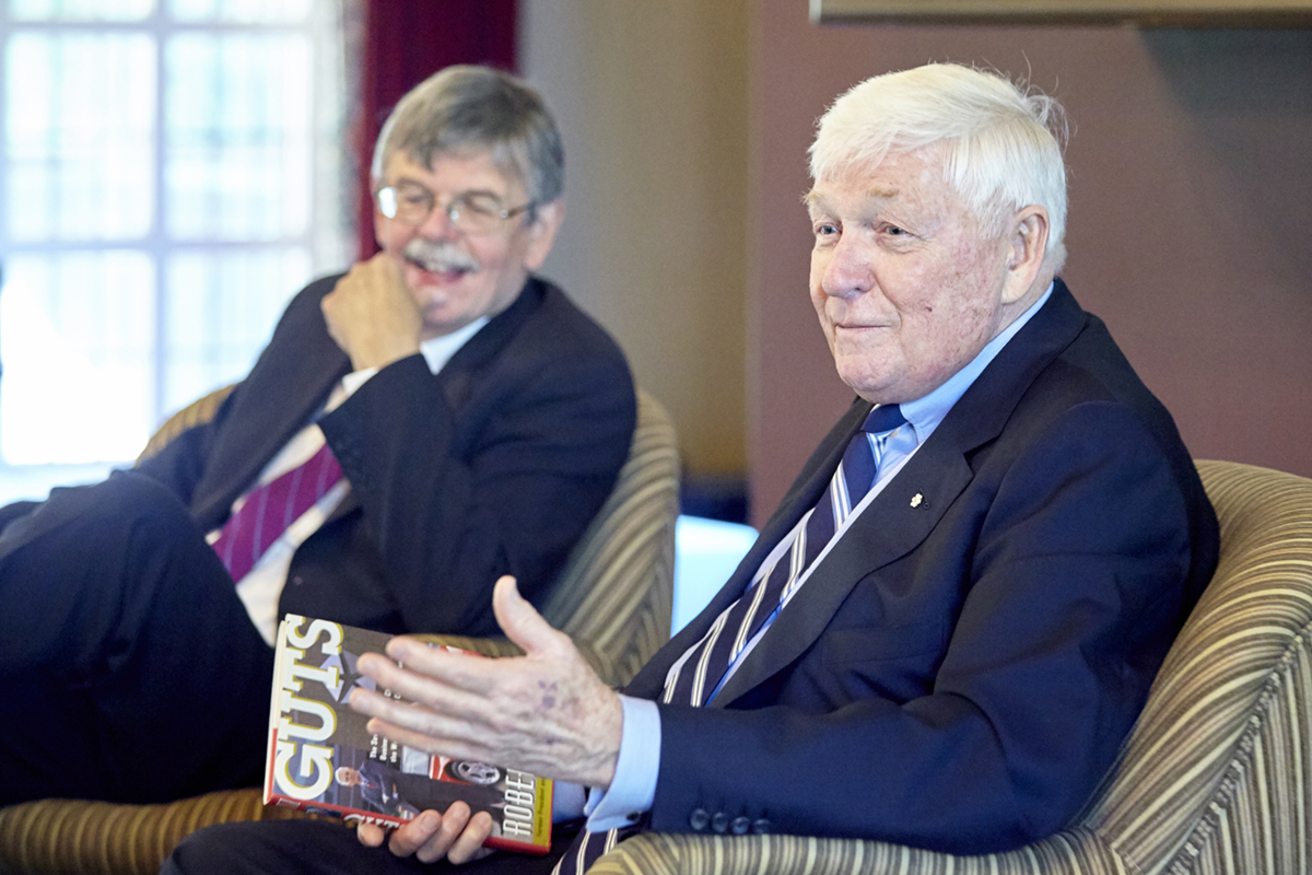 Red Wilson, Chancellor emeritus of McMaster University (right) chats with Gordon Pitts, Business Writer in Residence
