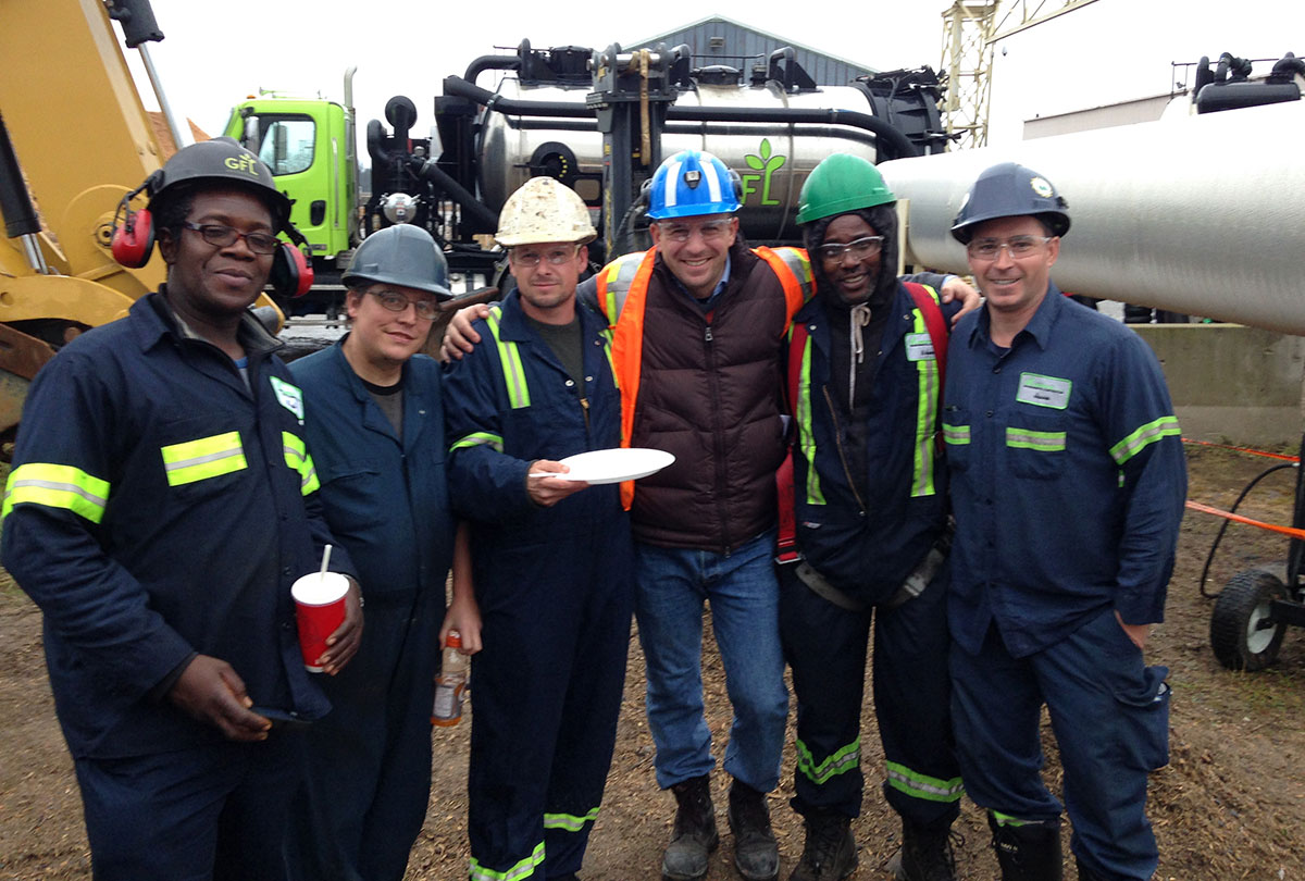 Marco De Bartolo (centre, orange vest) poses with a GFL Environmental Inc. work crew in Northern Ontario. De Bartolo, who earned a Certificate of Completion from the Executive Management Program in 2016, is a Senior Account Manager with Univar Canada.
