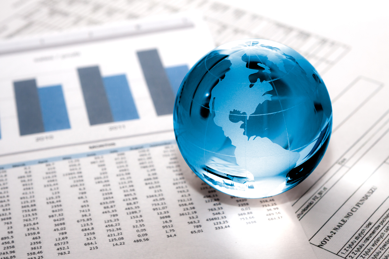 Blue globe showing North America on top of financial papers.