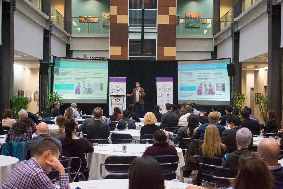 A record number of attendees watch as keynote speaker Jim Magahey of IBM Canada discusses the link between technology and life science innovation within Canadian communities.