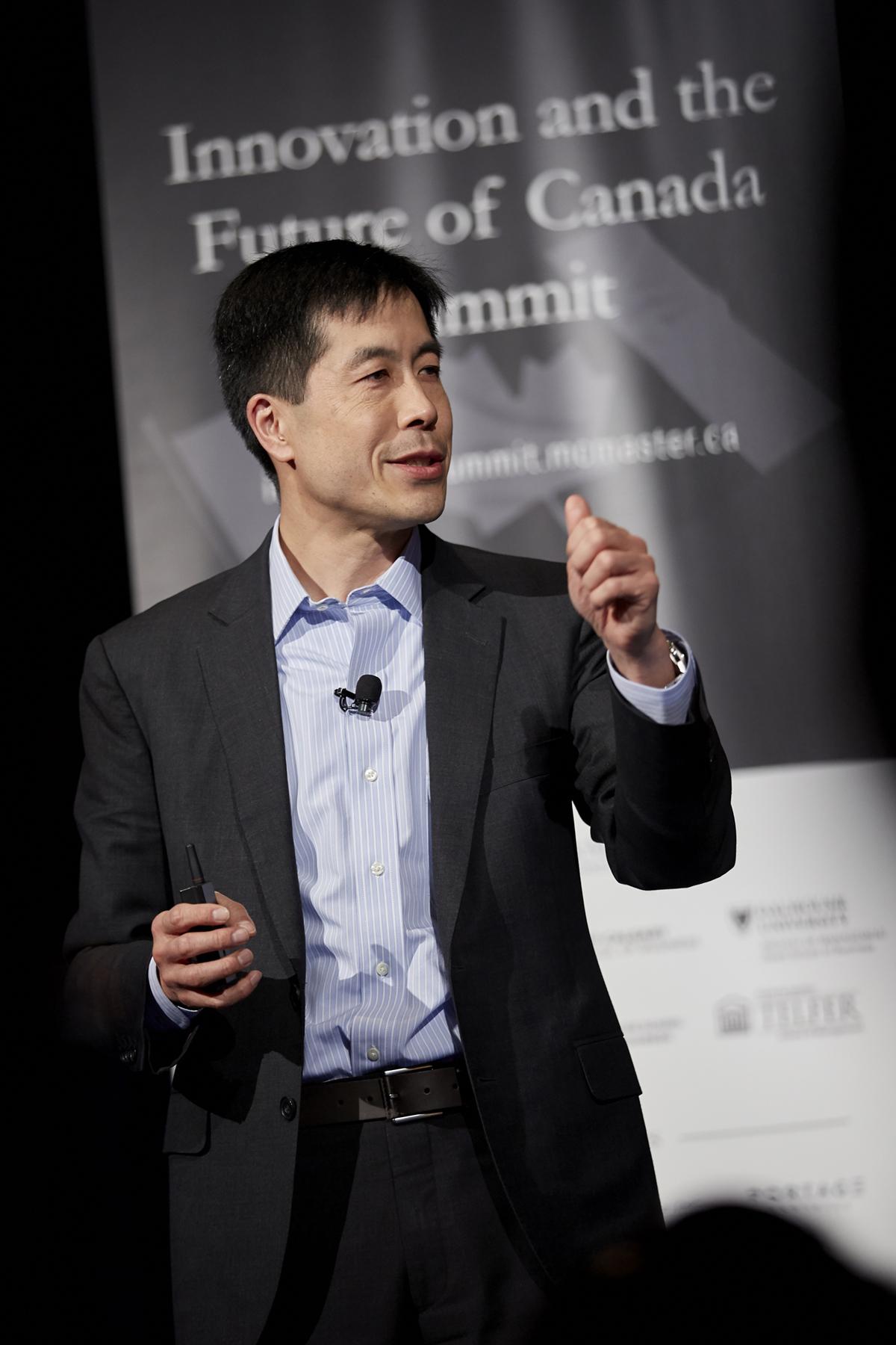 Michael Chui speaking on stage.