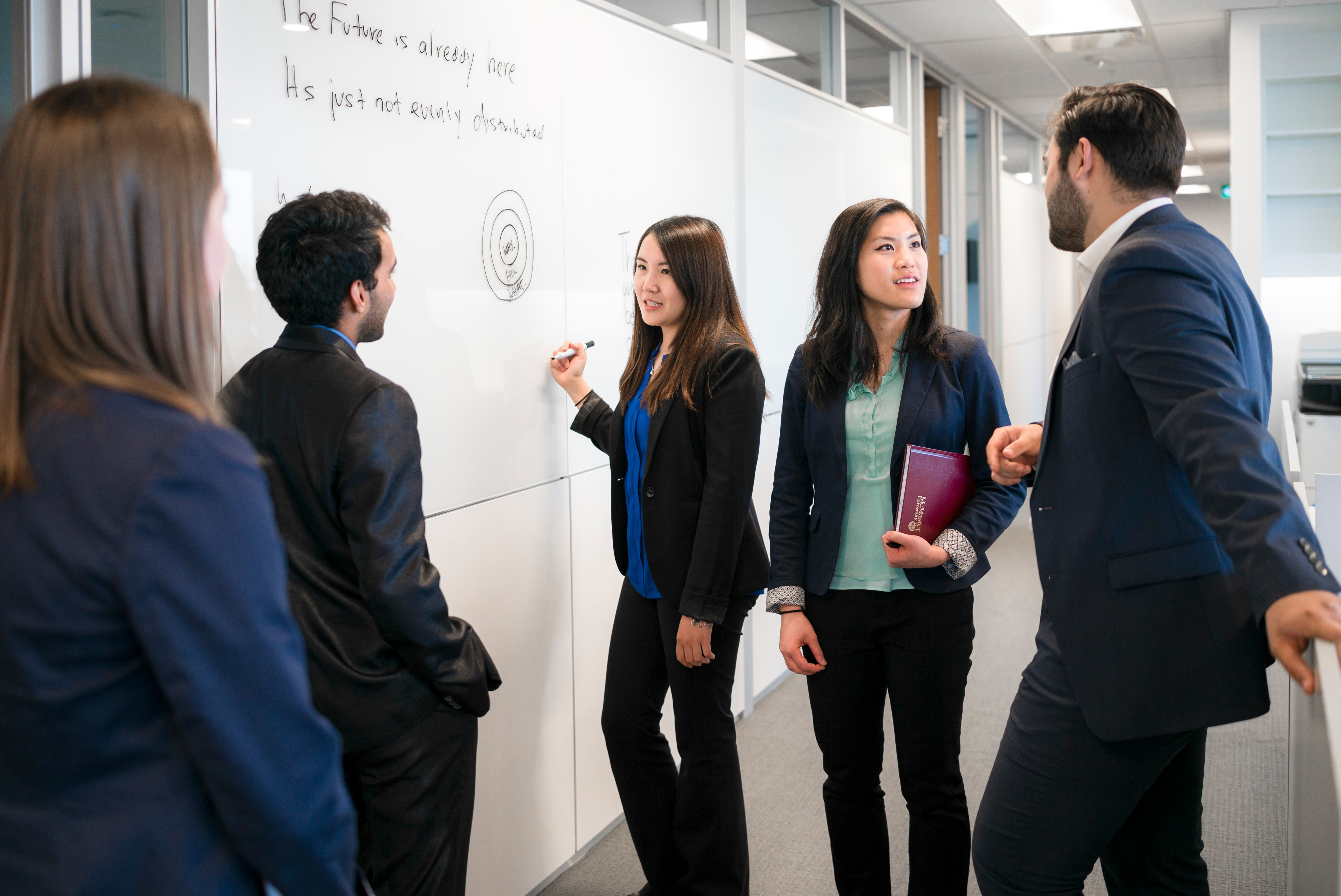Students working at a whiteboard