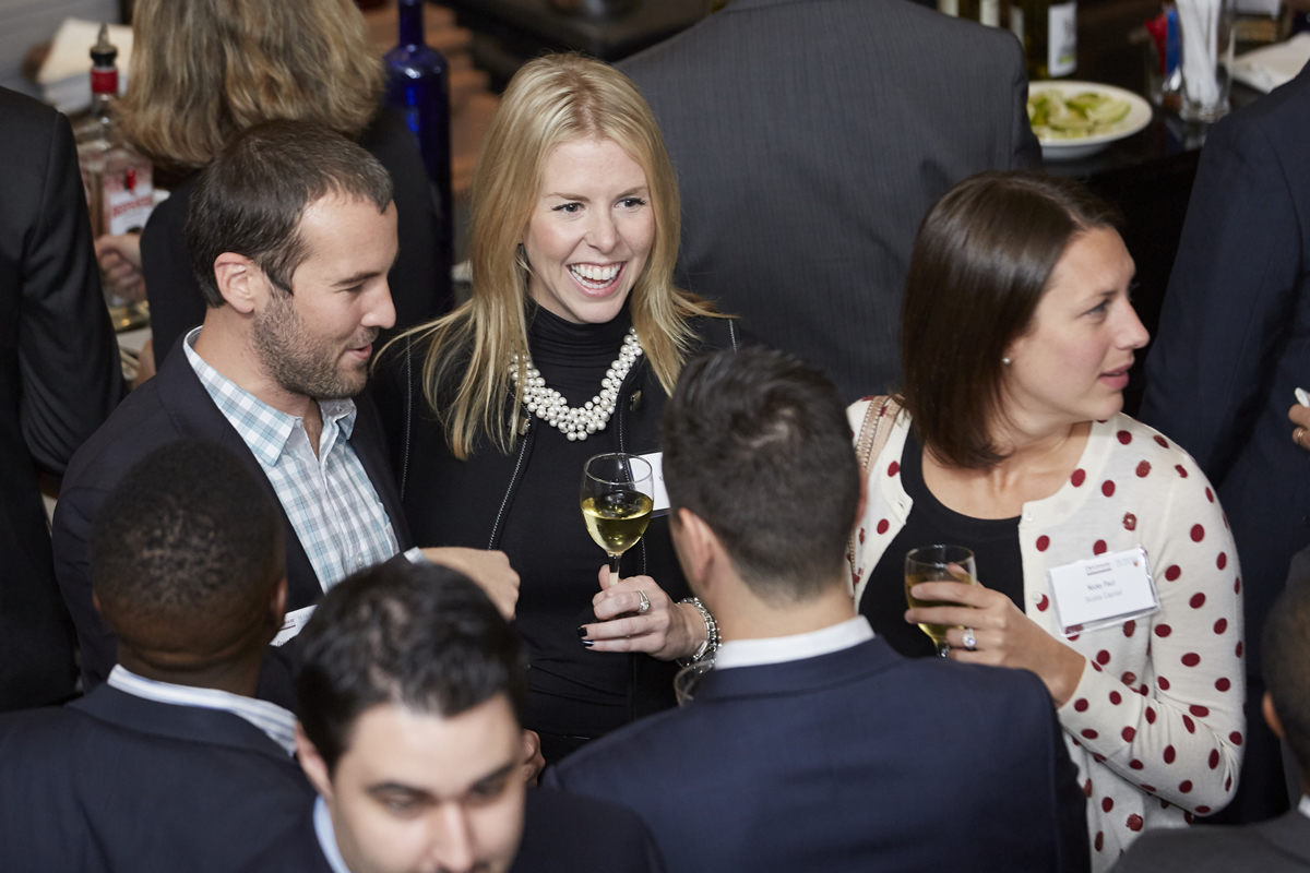 Several people mingling at an event.