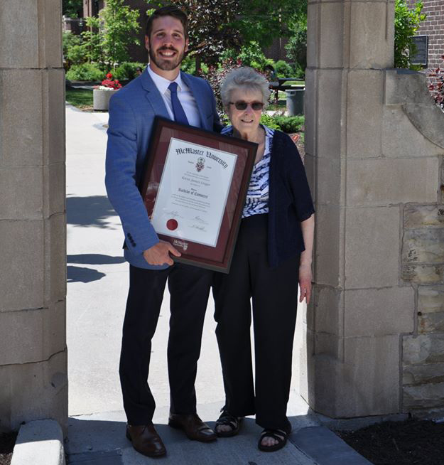 Kevin and his Grandmother standing under the McMaster Arch after his graduation ceremony.