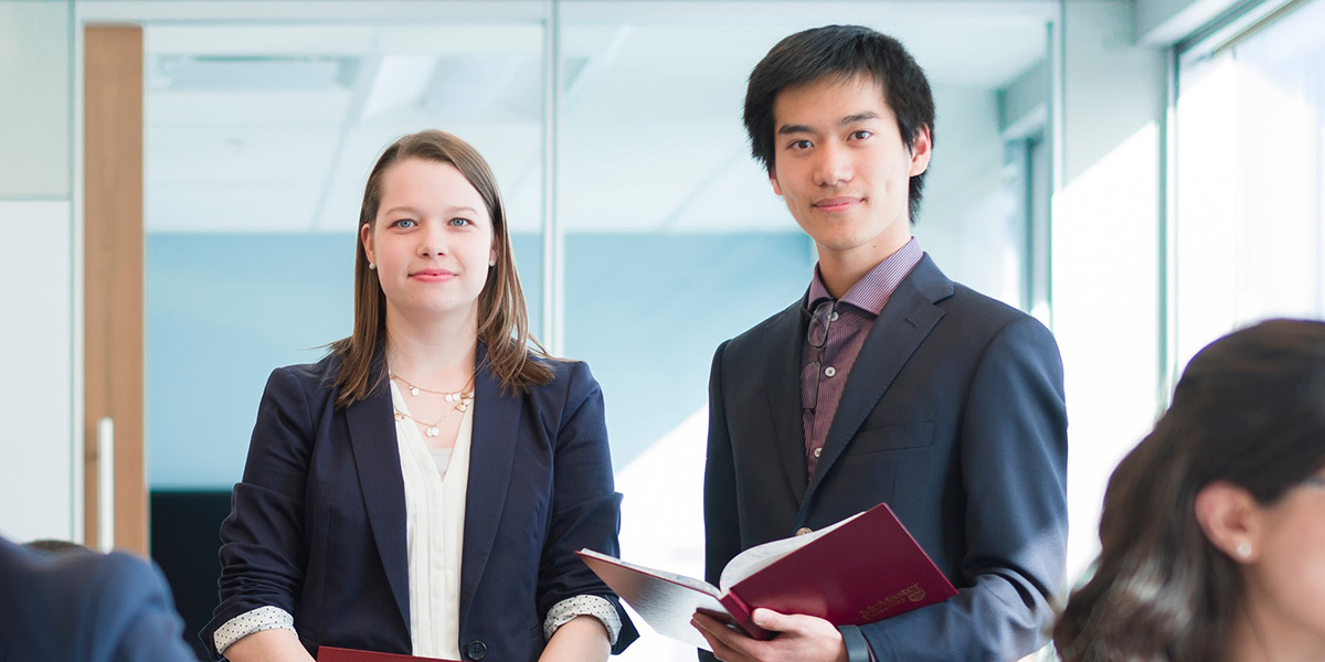 Two Students in Business Clothes