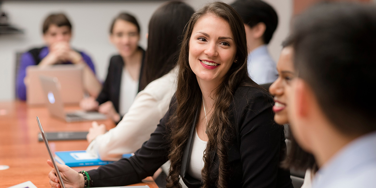 Woman Smiling at a Meeting Table