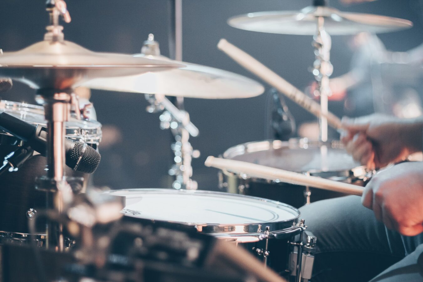 Drummer playing in band