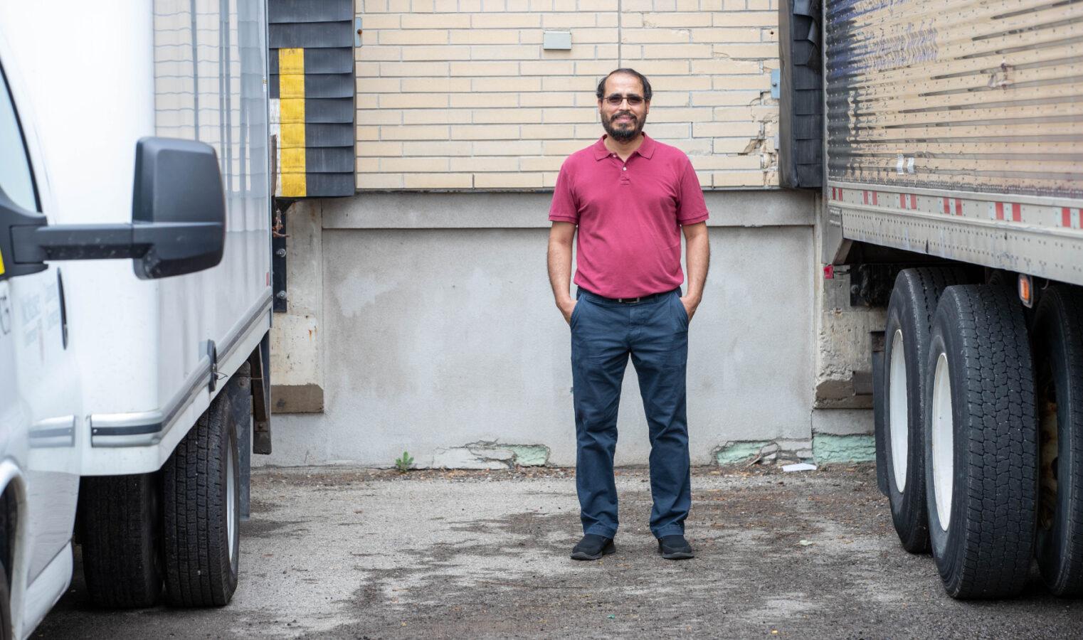 Elkafi hassini standing between trucks