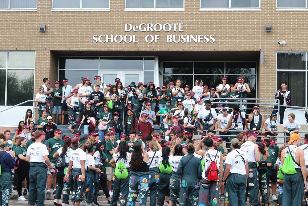 greensuits in front of DeGroote building