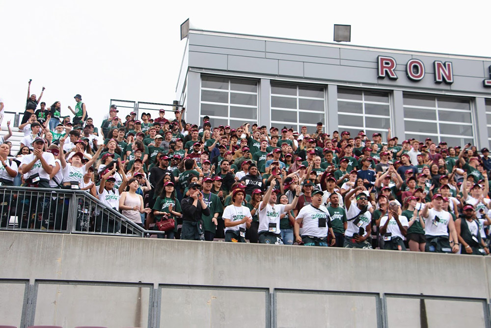 greensuits gathered on bleachers