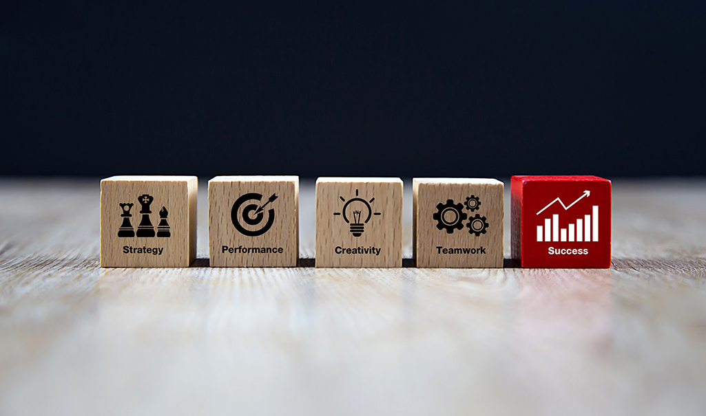 Wooden cubes with business icons for planning, strategy and success concept