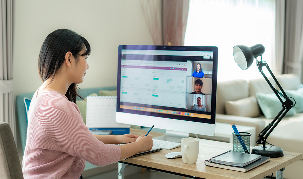 Woman talking on video conference.