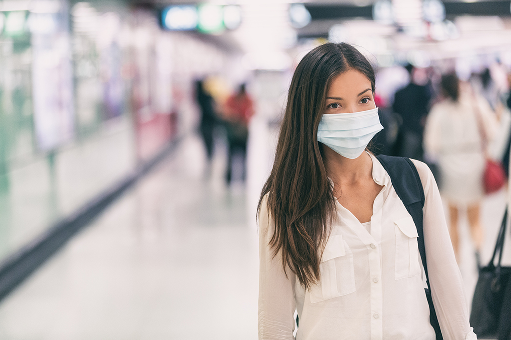 Woman wearing mask at airport