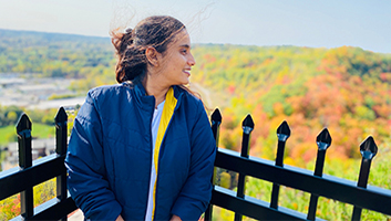Megha looking into the distance in the fall from escarpment