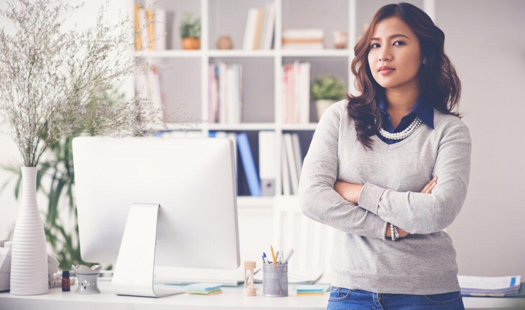 Female entrepreneur in front of desk in home office