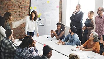 Group of diverse people in meeting room brainstorming