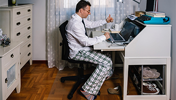 Man working from home with no dress pants
