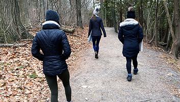 Rachel West walking in the forest