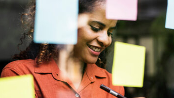 Woman brainstorming with post-it notes