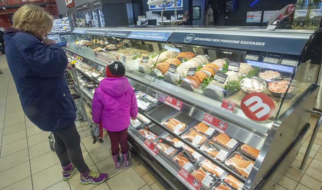 A customer looks at the seafood counter at a Metro store in Ste-Therese, Que. (The Canadian Press/Ryan Remiorz) middle class retail