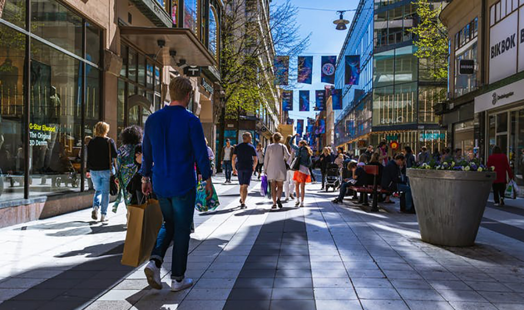 People shop in Stockholm, Sweden. (Tomas Williams/Unsplash) middle class retail
