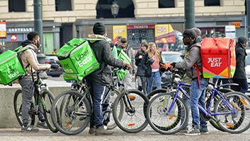 Food delivery couriers congregate in Turin, Italy. (Shutterstock)